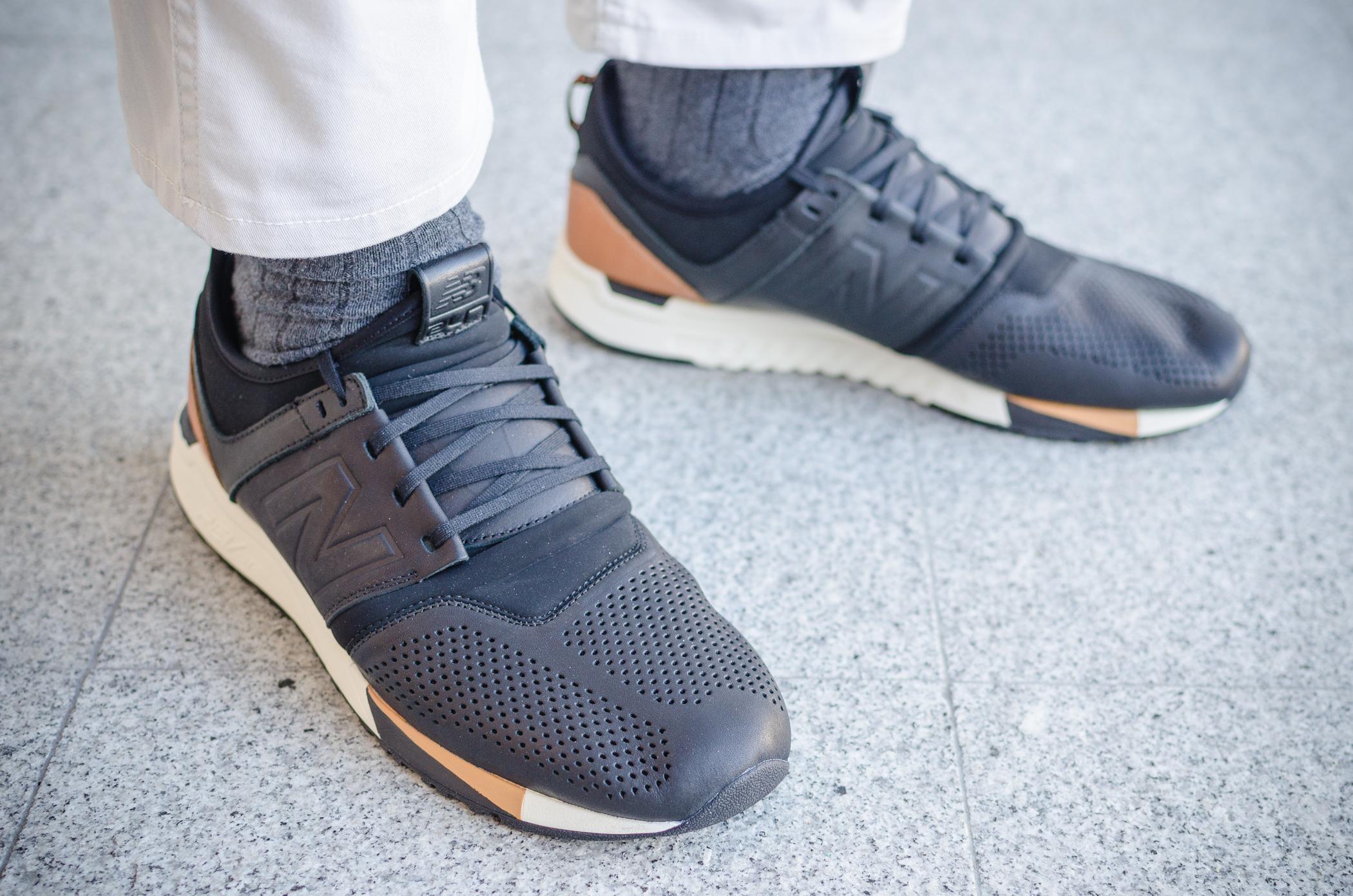 new balance 247 black on feet
